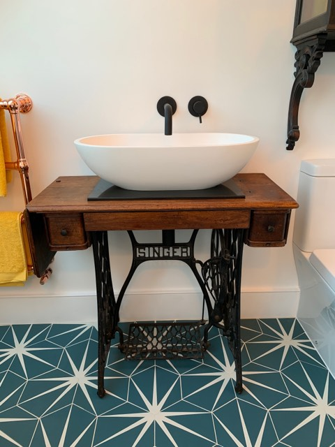 upcycling a sewing machine to a vanity unit is a great budget friendly bathroom idea