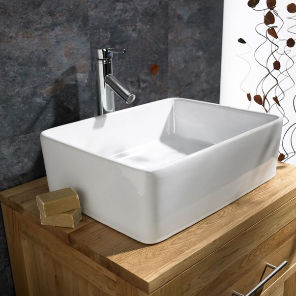 countertop basin on wooden vanity unit
