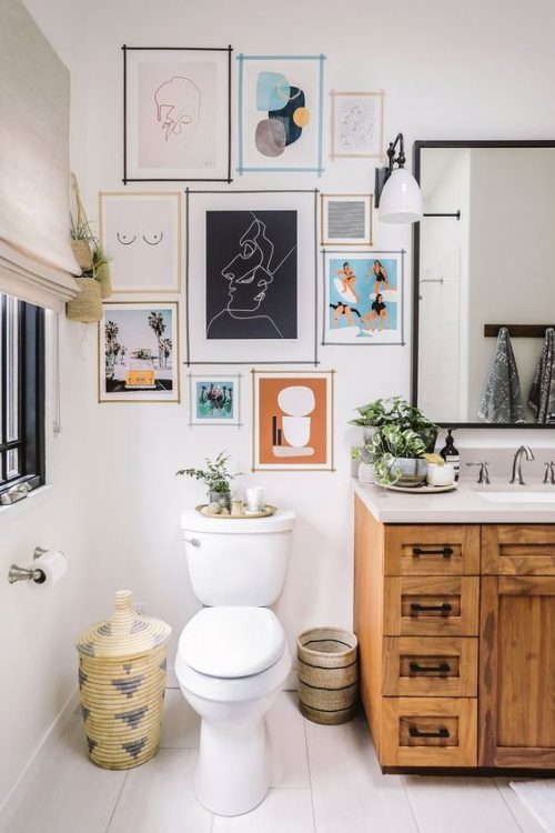 hanging pictures on the bathroom wall is a cheap makeover tip