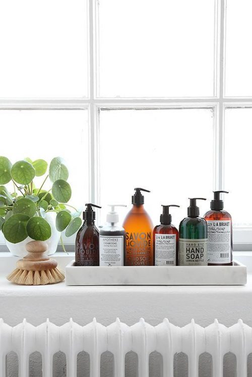 Put toletries in fancy bottles to enhance your bathroom