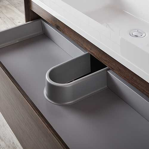 helpful storage drawer under a wall hung vanity unit